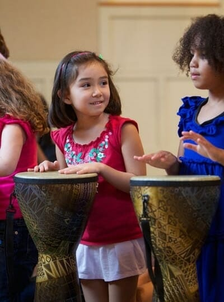 Girls Playing Drums in Rhythm Kids Class