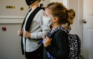 Kids ready for school wearing safety masks during the COVID-19 Pandemic